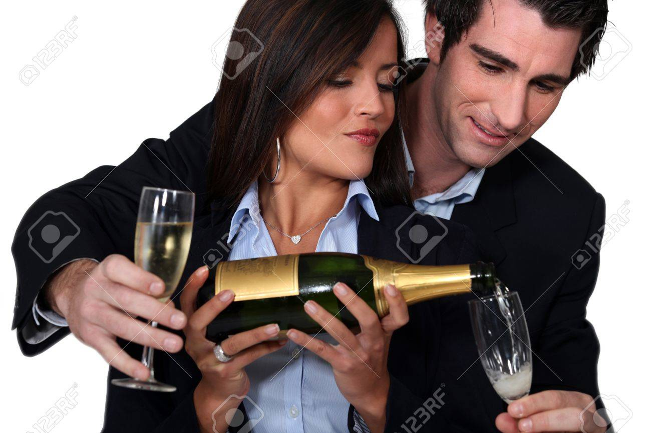 Couple celebrating with a glass of wine Stock Photo - 15410046