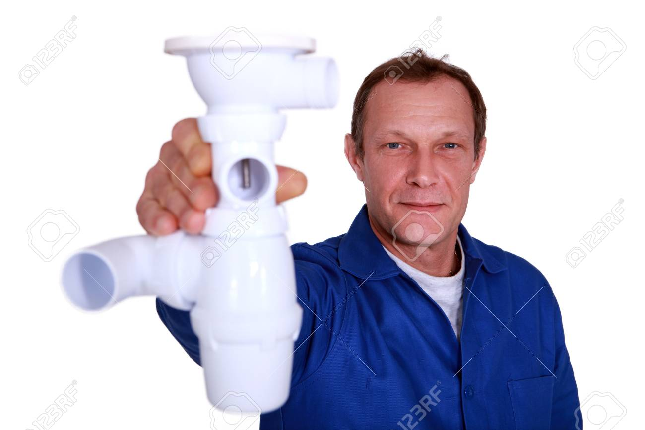 Plumber holding replacement part Stock Photo - 15573792