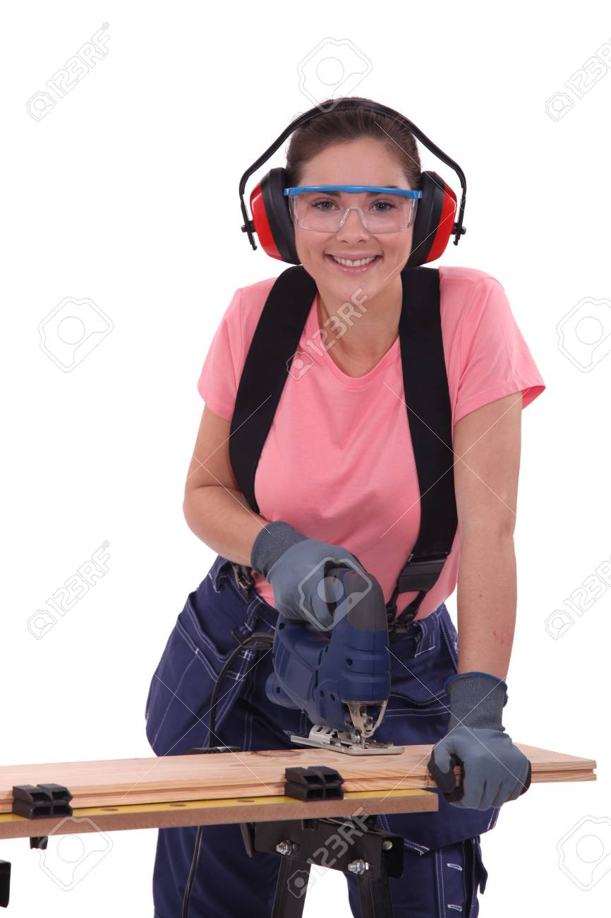 Woman using an electric jigsaw Stock Photo - 15573597