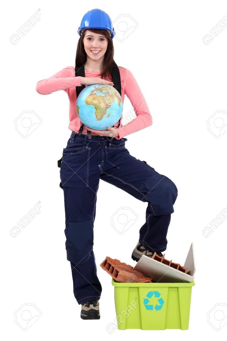 Female laborer holding globe Stock Photo - 15573472