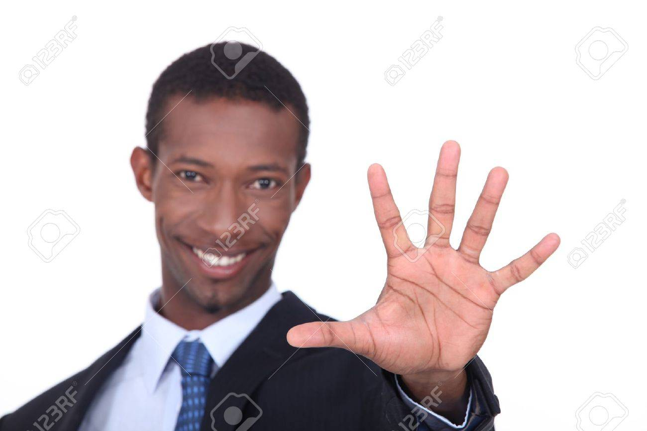 Studio shot of a businessman with the palm of his hand outstretched in front of him Stock Photo - 15573293