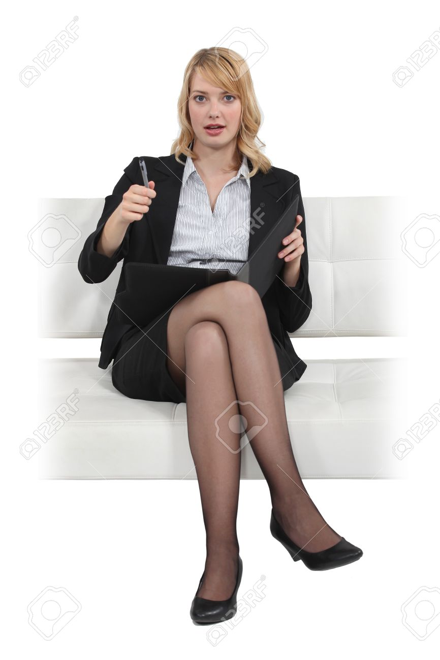 Blond businesswoman sat in chair with folder Stock Photo - 15686417