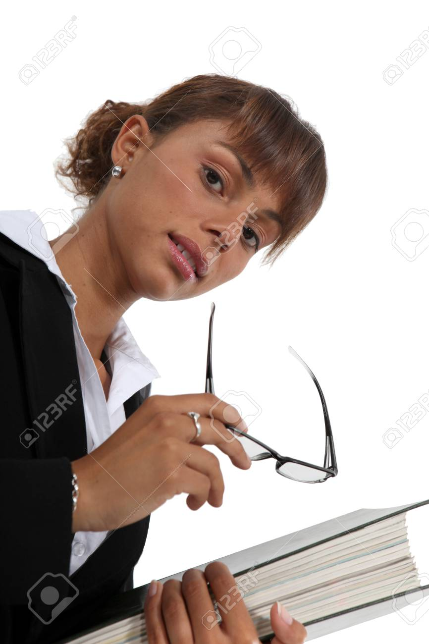Businesswoman carrying a binder Stock Photo - 15672414