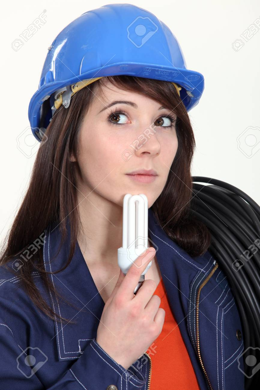 Thoughtful woman holding a compact fluorescent lamp Stock Photo - 15676214