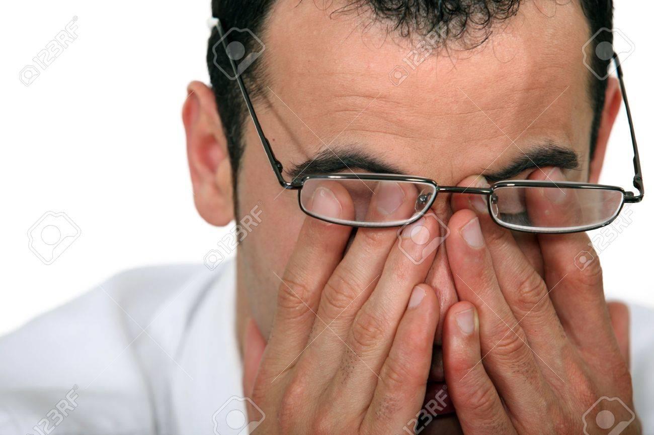 Tired man rubbing his eyes - 15718365