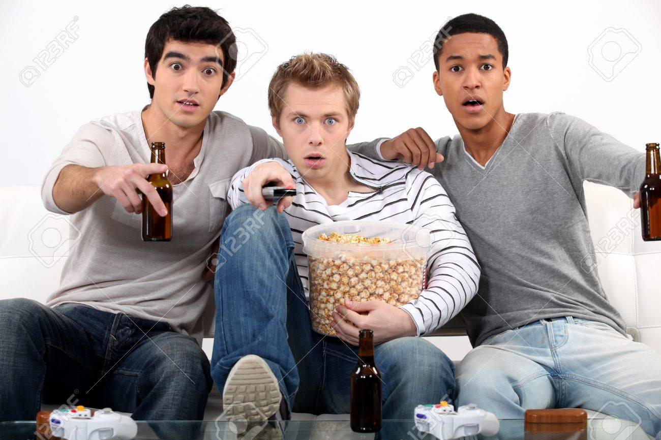 men watching a horror movie stock photo picture and royalty men watching a horror movie stock photo 15819422