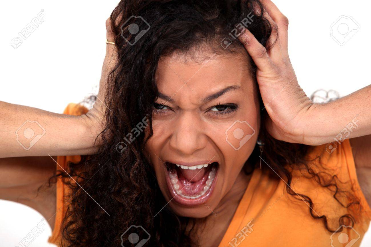 Portrait of a young woman screaming Stock Photo - 15807454
