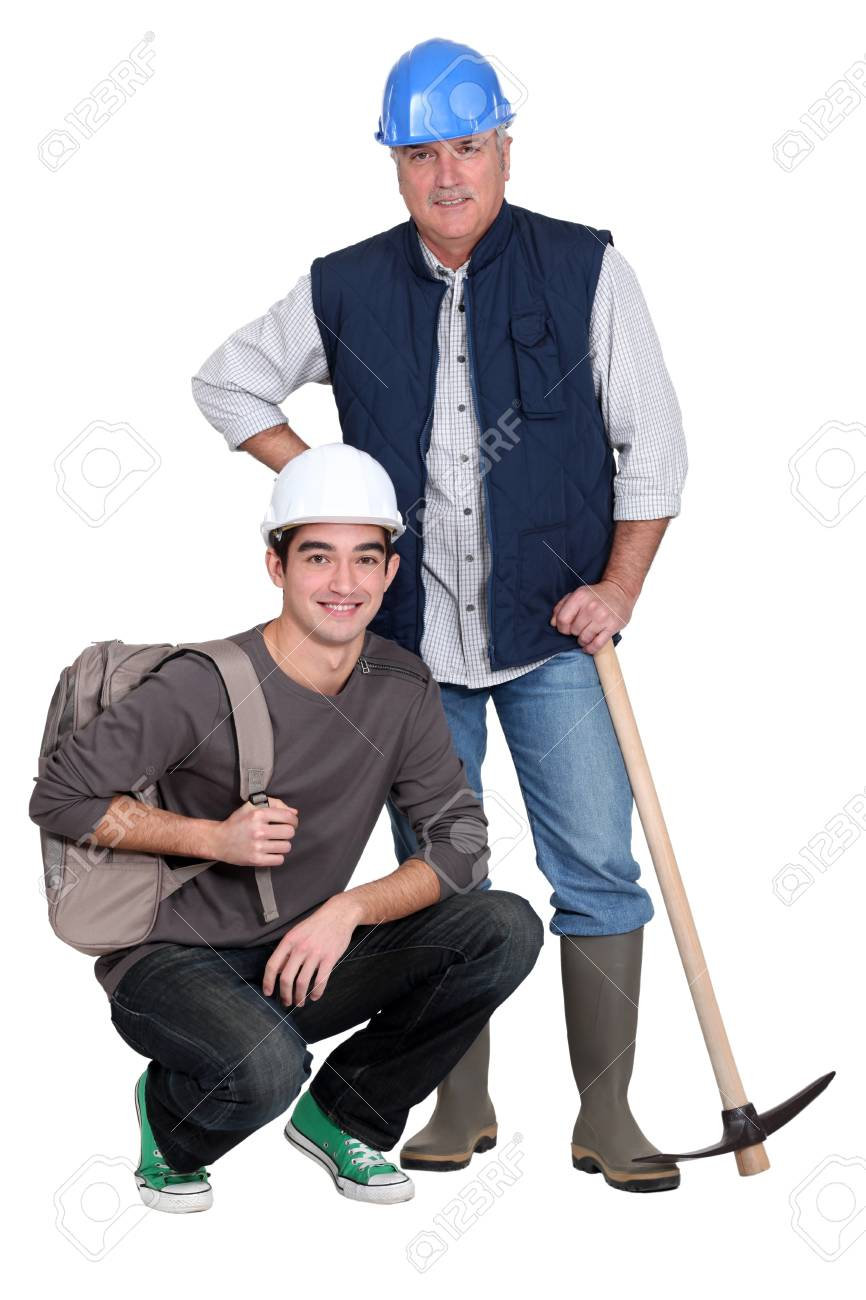 Experienced tradesman posing with his new apprentice Stock Photo - 15832950