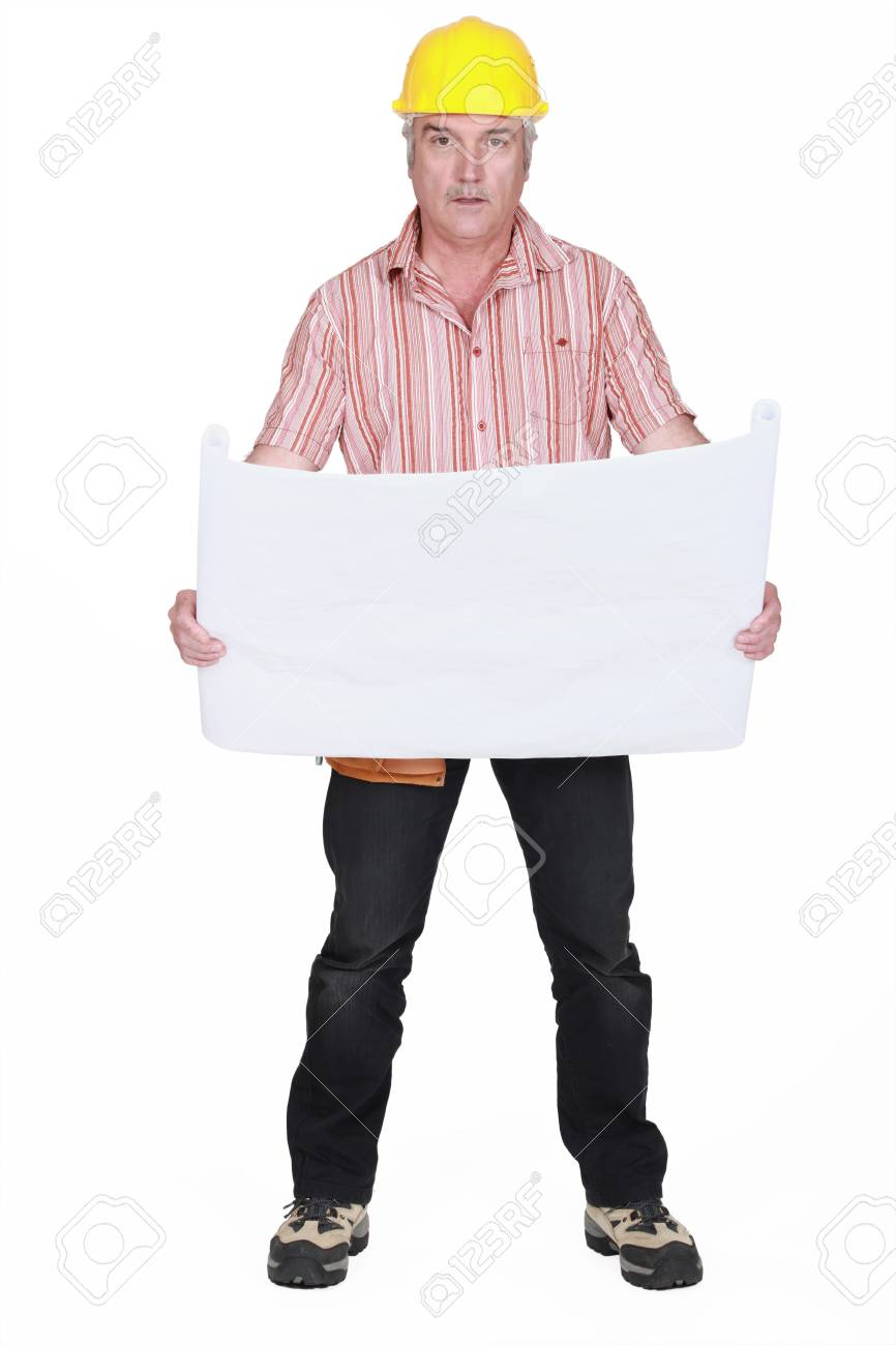 A mature architect reviewing his plans Stock Photo - 15853661