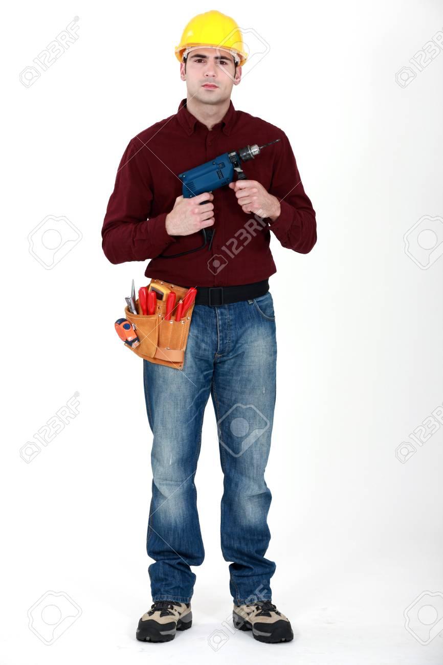 Man holding power-drill Stock Photo - 15915929