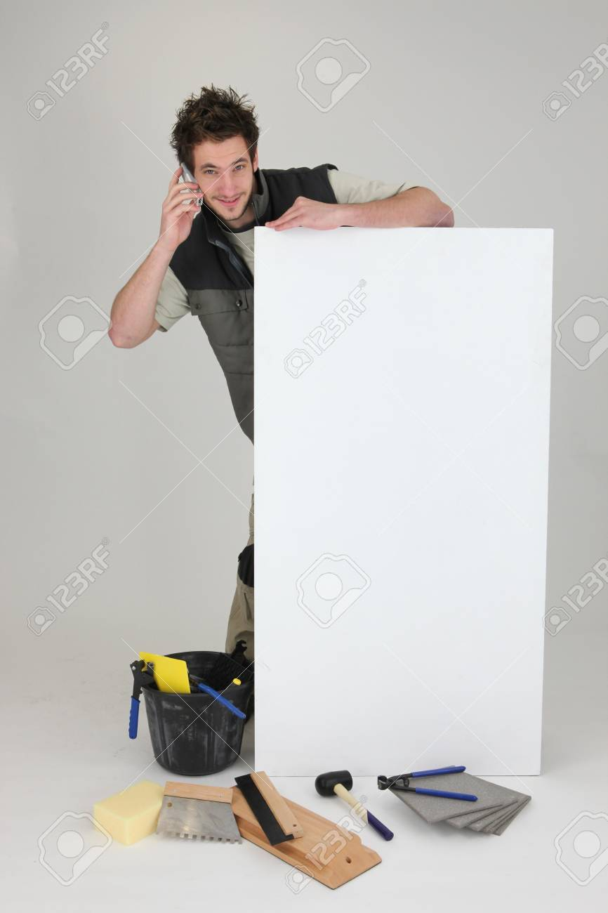 Handyman on tiling job Stock Photo - 16037469