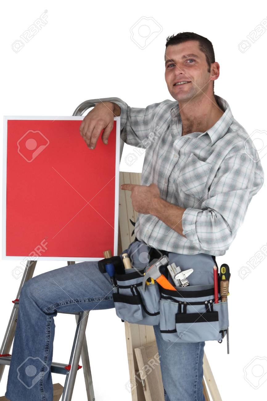 Carpenter posing with red poster Stock Photo - 16037794