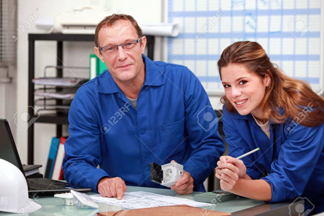 Colleagues ordering parts Stock Photo - 16037401