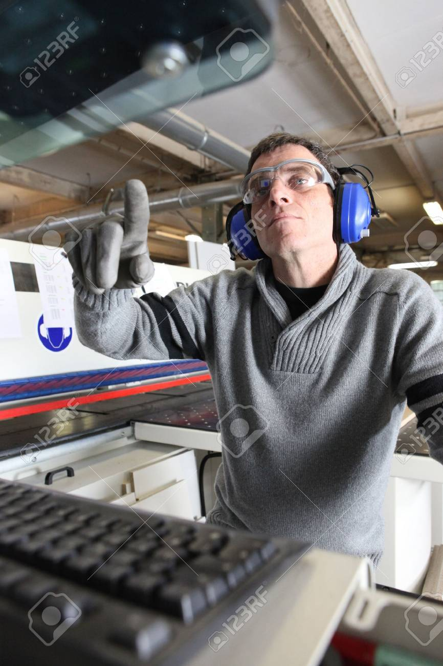 Man using computer controlled factory machine Stock Photo - 16166298