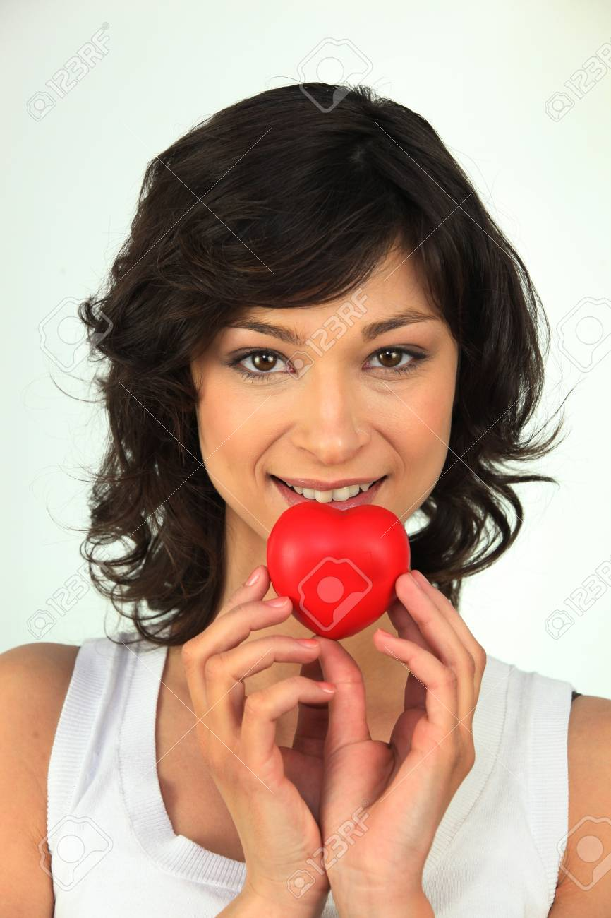 Young woman with red heart in hand Stock Photo - 16191581