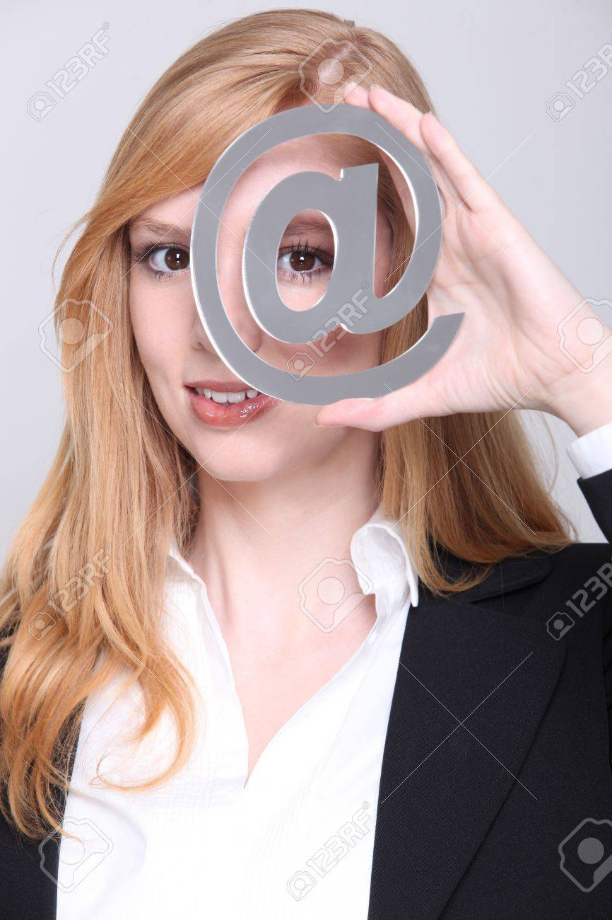 Blond looking through metallic at symbol Stock Photo - 16191573