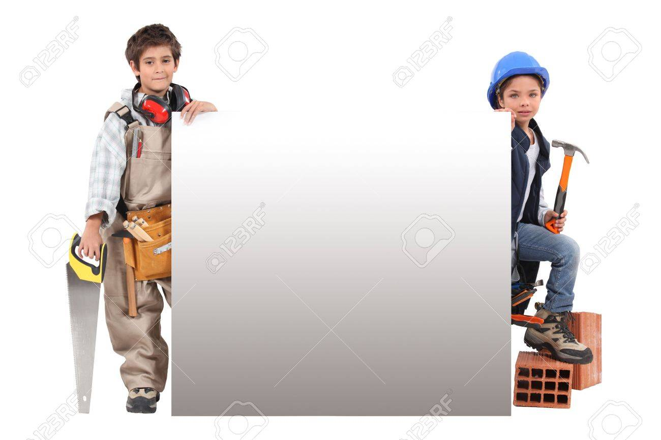 Children pretending to be construction workers standing around a blank sign Stock Photo - 16190426
