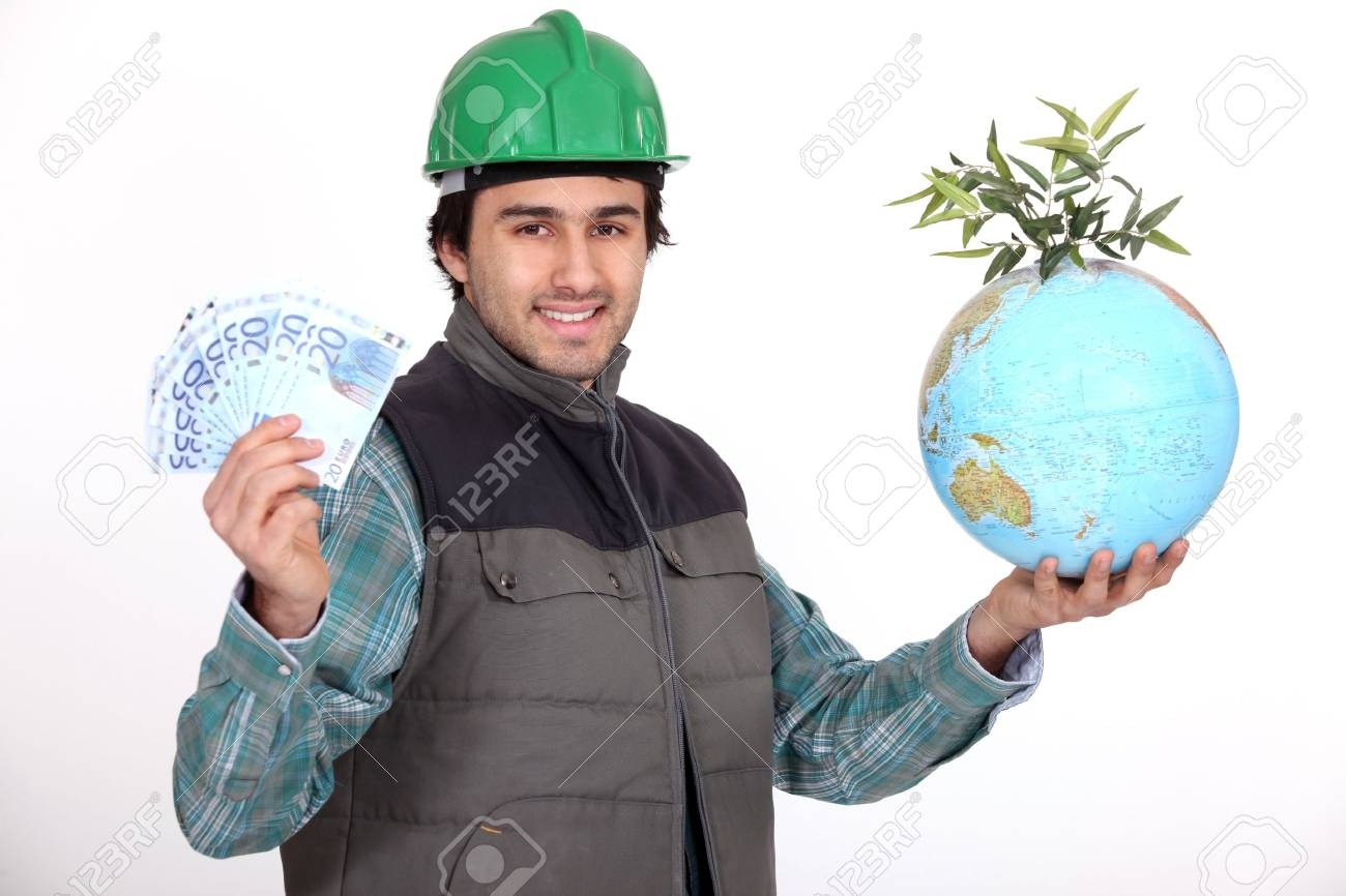 Tradesman holding a globe and a wad of money Stock Photo - 16191470