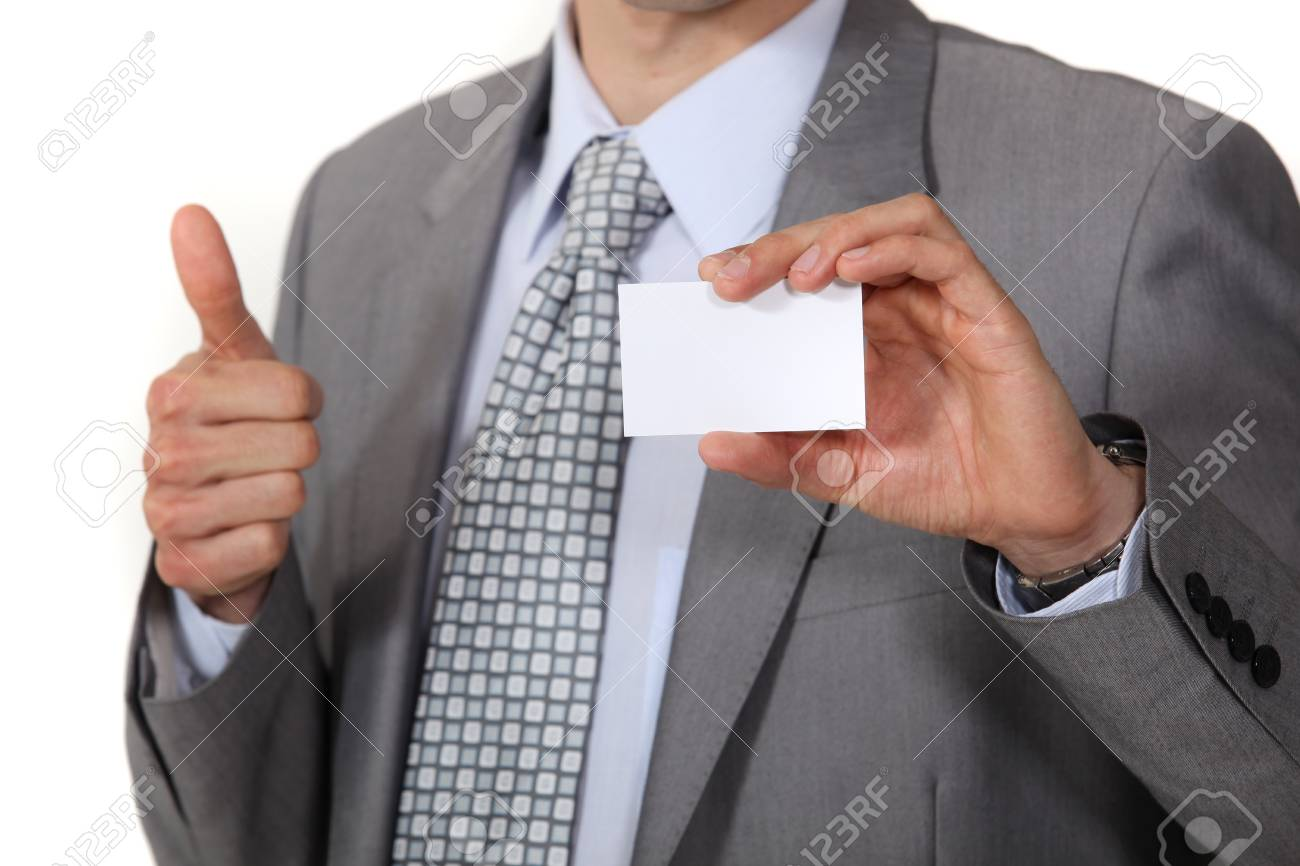 businessman thumb up showing business card Stock Photo - 16336799