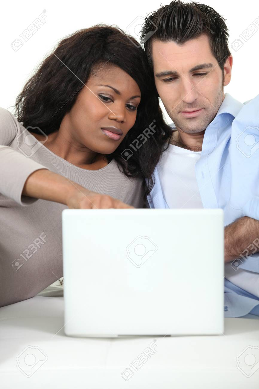 A couple looking at their laptop Stock Photo - 16411290