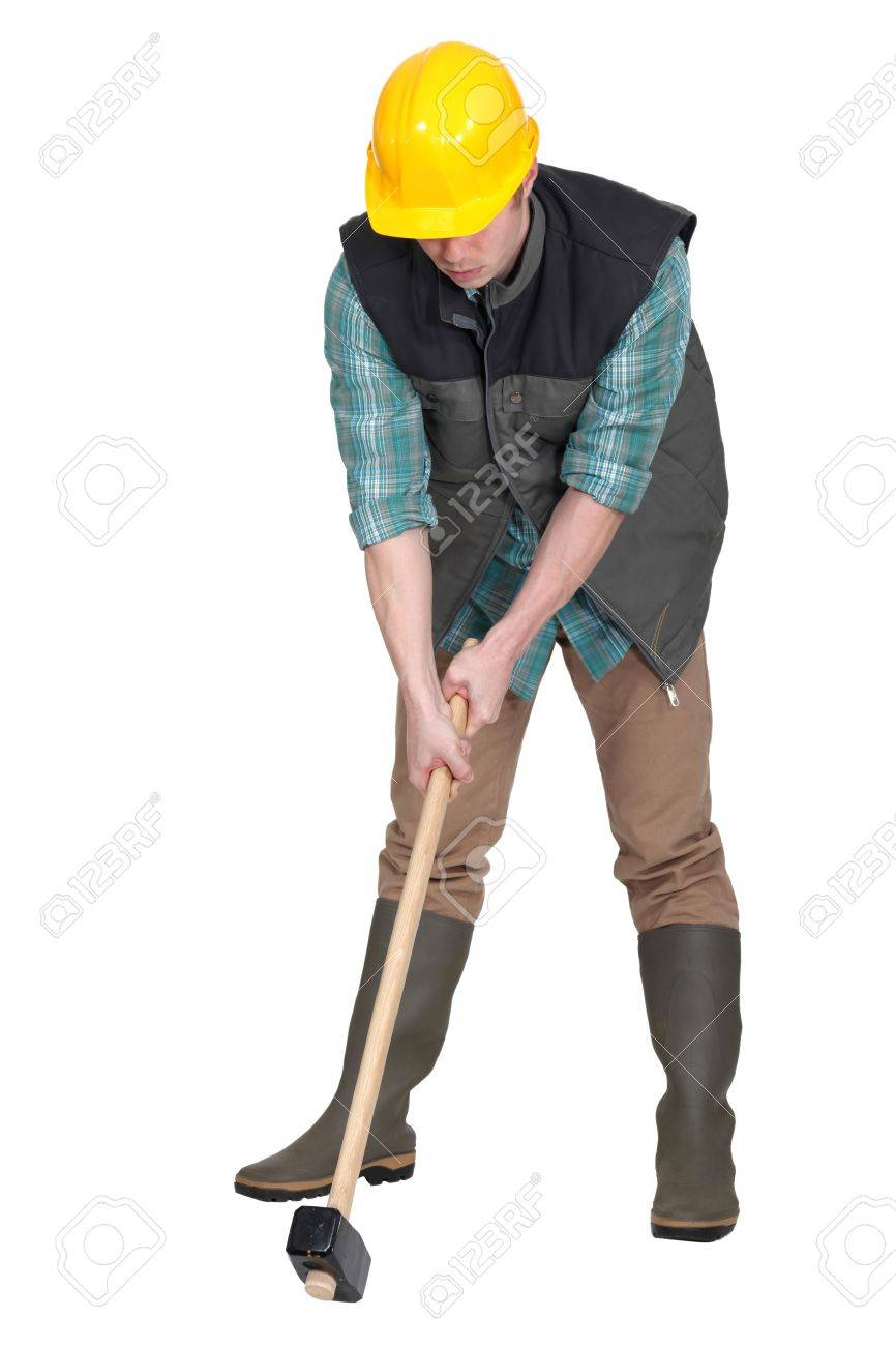 Man trying to lift sledge-hammer Stock Photo - 16671010