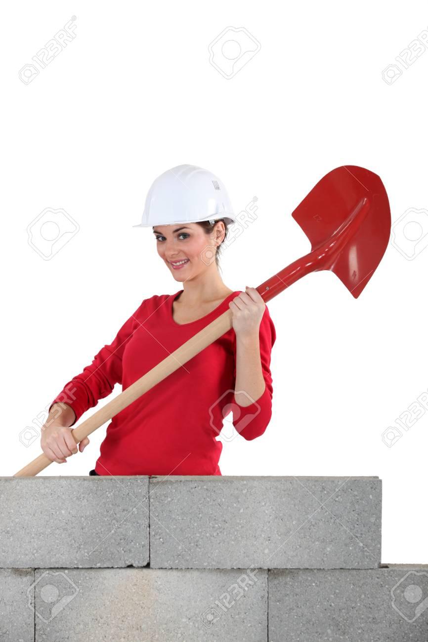 Woman mason holding a shovel Stock Photo - 16670500
