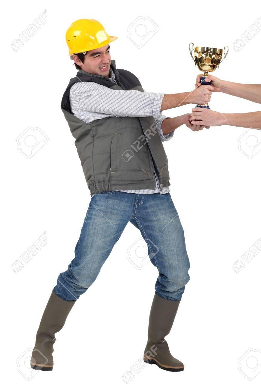 Builder fighting for trophy