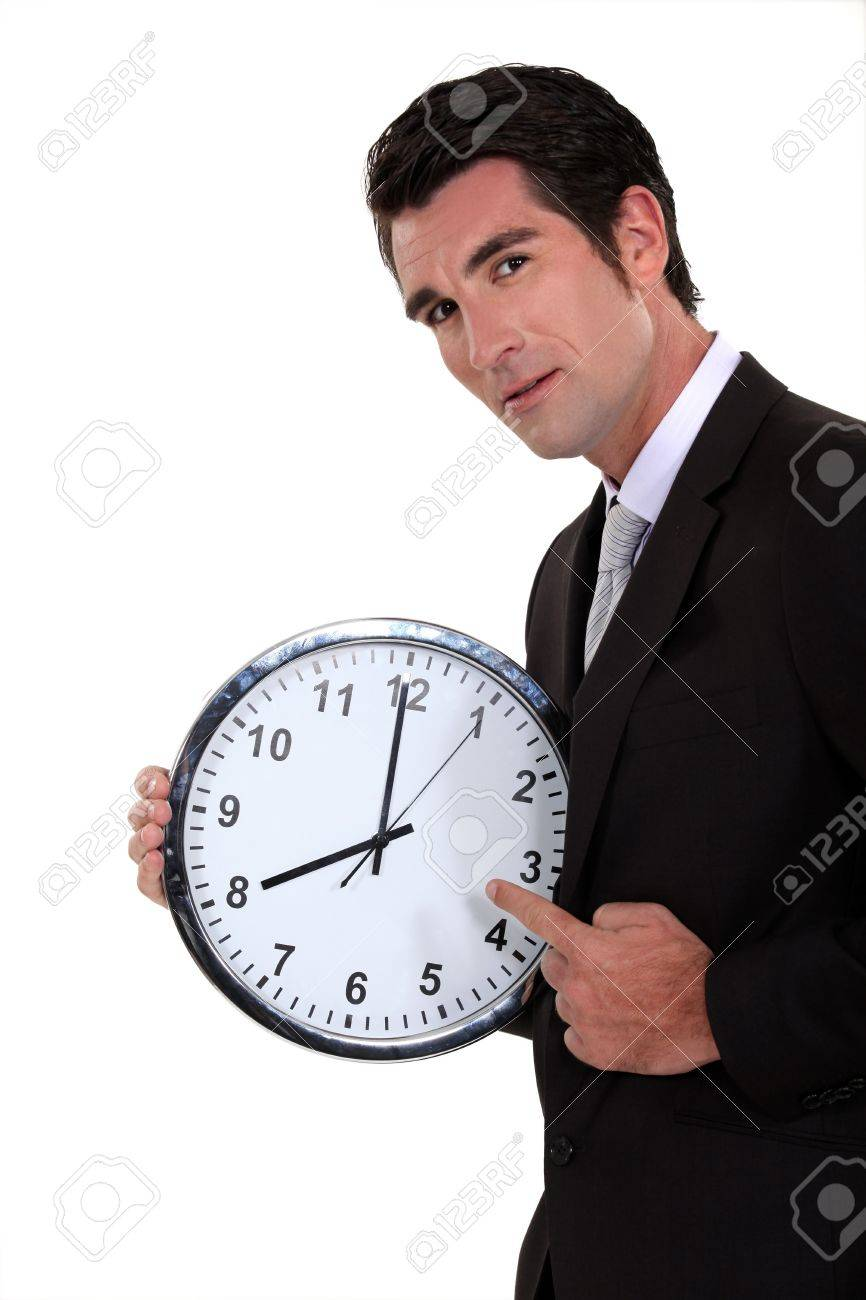 Man pointing to clock Stock Photo - 16670708