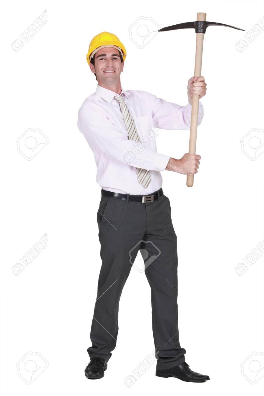 Architect holding a pick-ax Stock Photo - 16716453