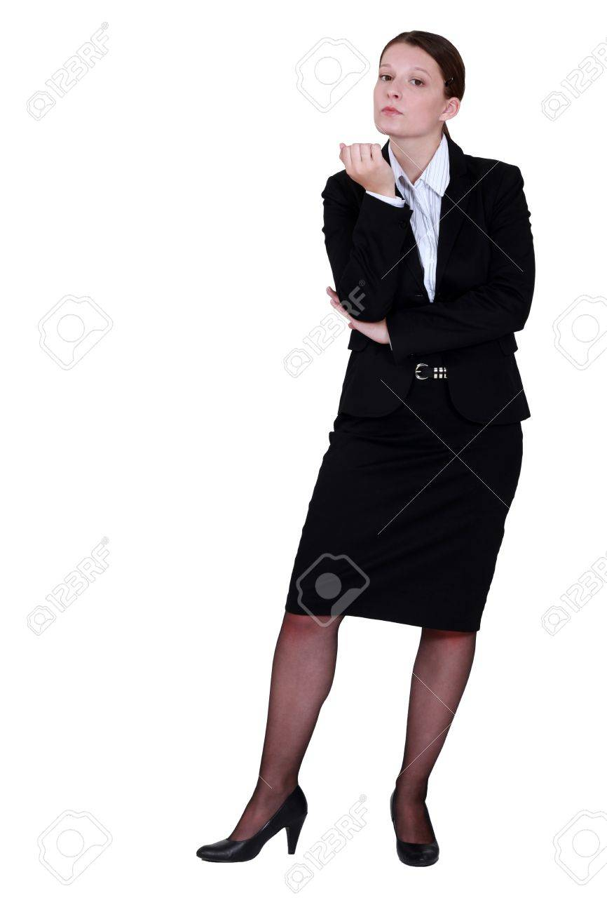 Businesswoman inspecting her nails Stock Photo - 16716187