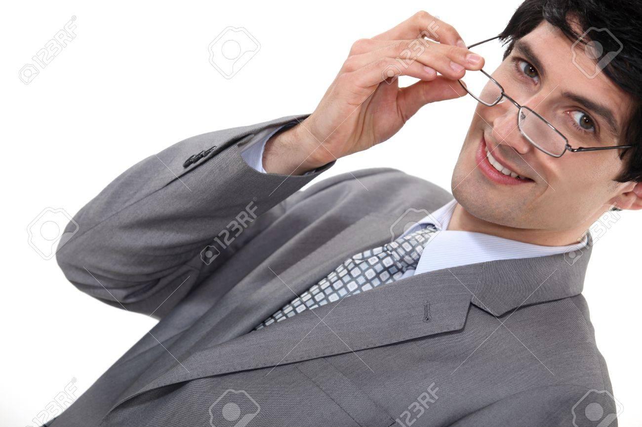 Businessman removing glasses Stock Photo - 16808396