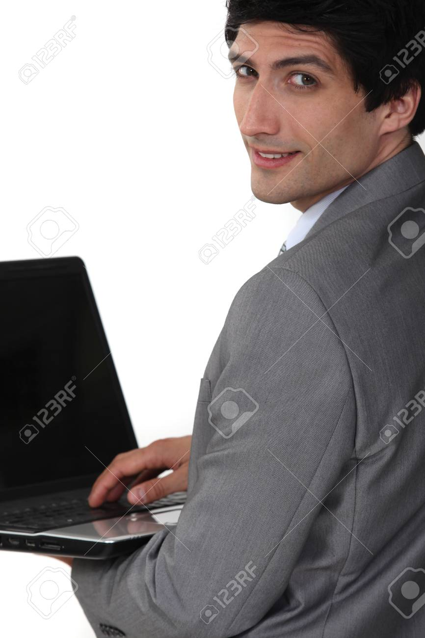Young businessman working on notebook Stock Photo - 16808414