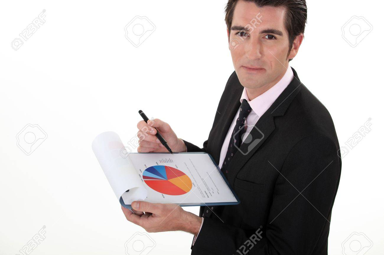 Man holding pie-chart and pen Stock Photo - 16807446