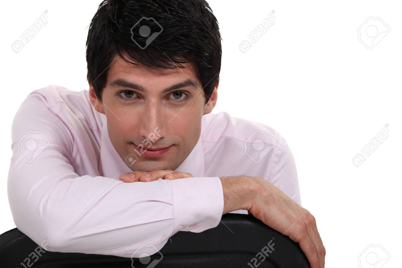 Businessman sat on chair backwards Stock Photo - 16807766