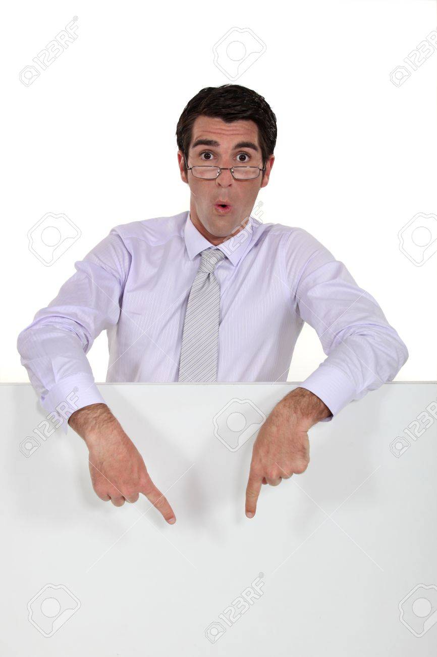 Excited man pointing to a sign Stock Photo - 16807432