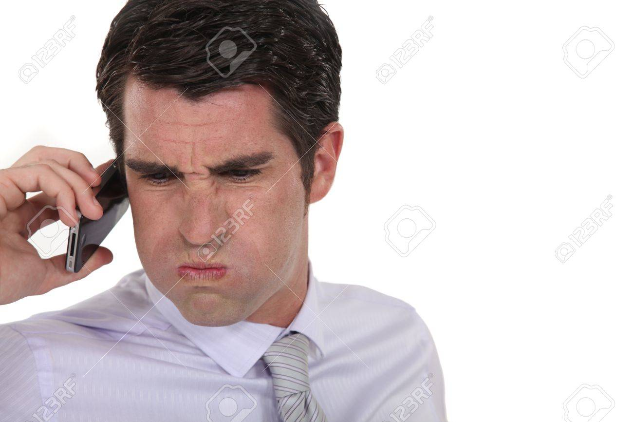 An angry businessman over the phone Stock Photo - 16807556