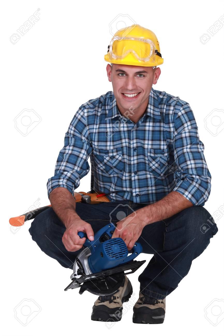 Smiling man with a circular saw Stock Photo - 16842002