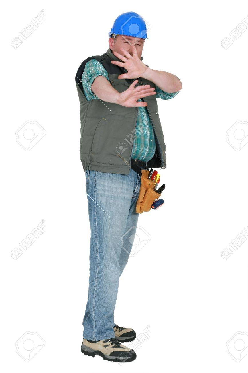 Builder shielding his face in fear Stock Photo - 16890057