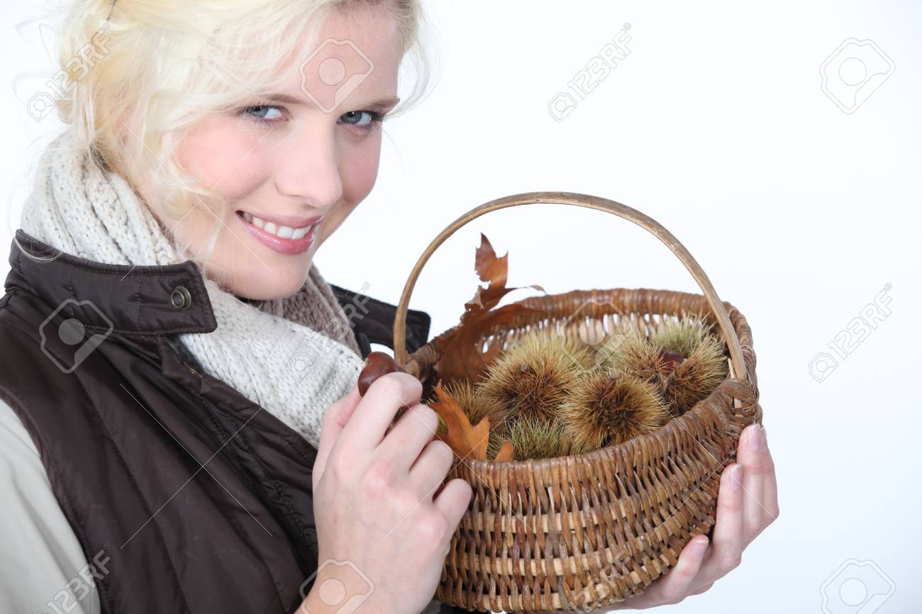 Woman with basket of chestnuts Stock Photo - 16901163