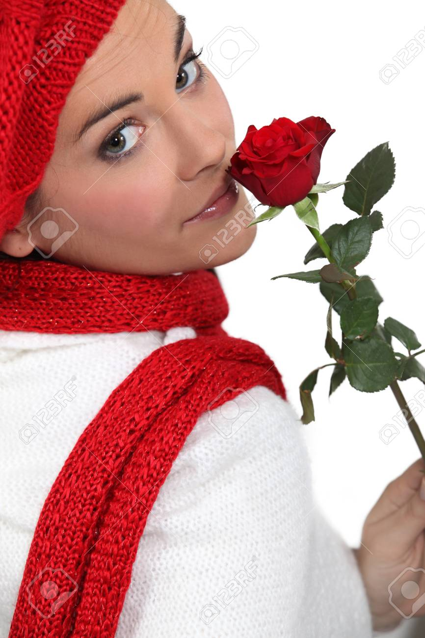 Woman holding single red rose Stock Photo - 16901155