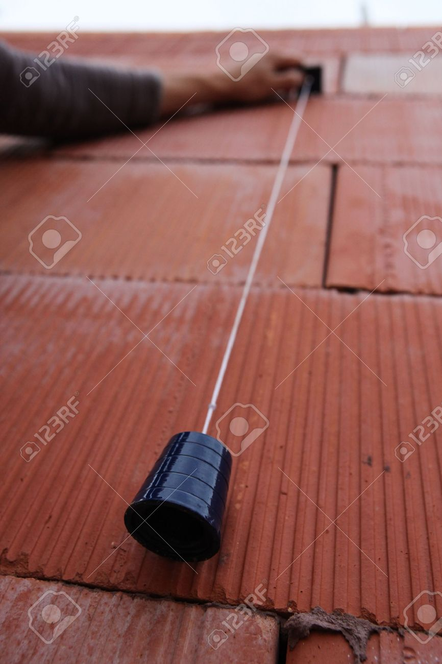 Bricklayer Using A Plumb Line Stock Photo Picture And Royalty Free