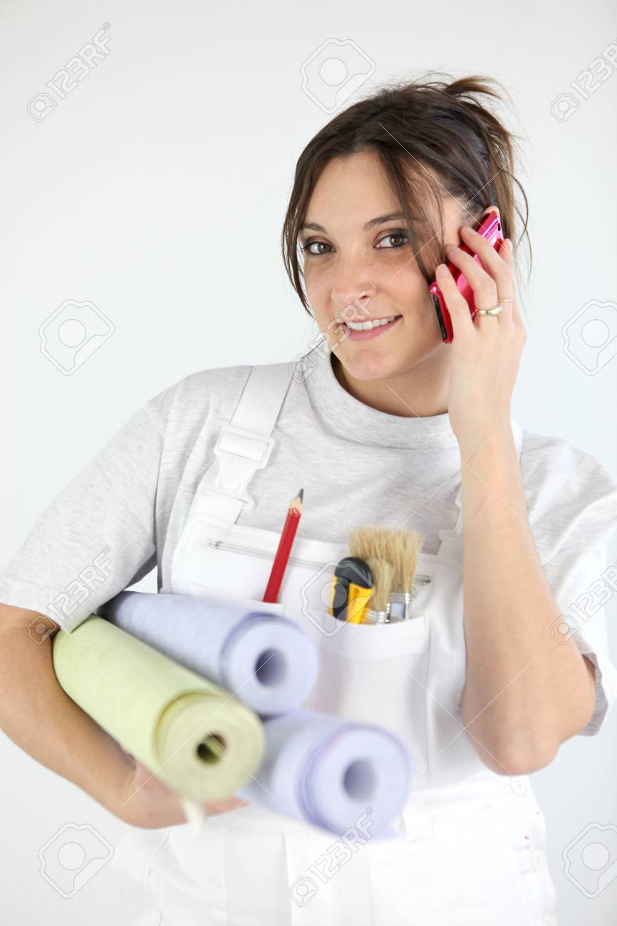 Portrait of woman paperhanger on the phone Stock Photo - 16950598