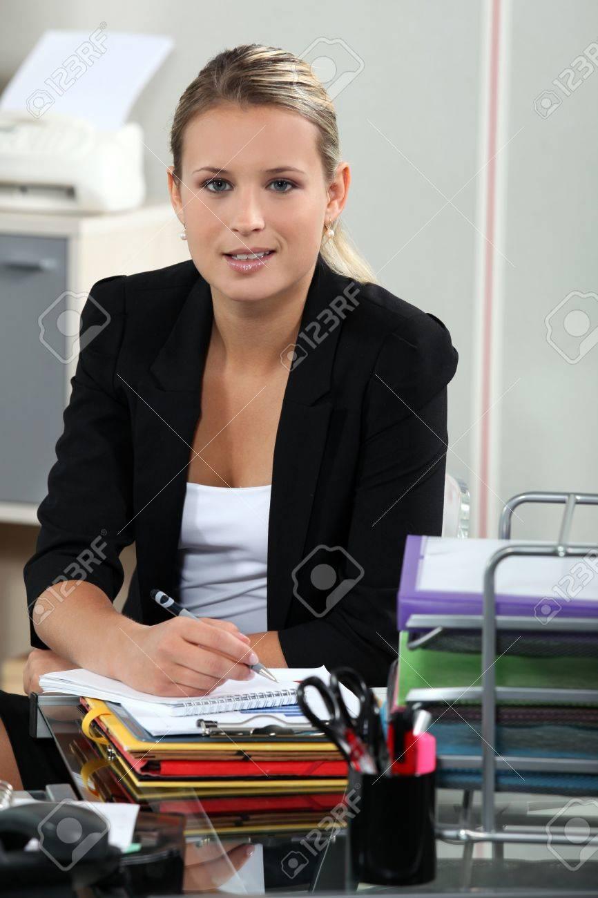 Blond receptionist sat at her desk Stock Photo - 17219370