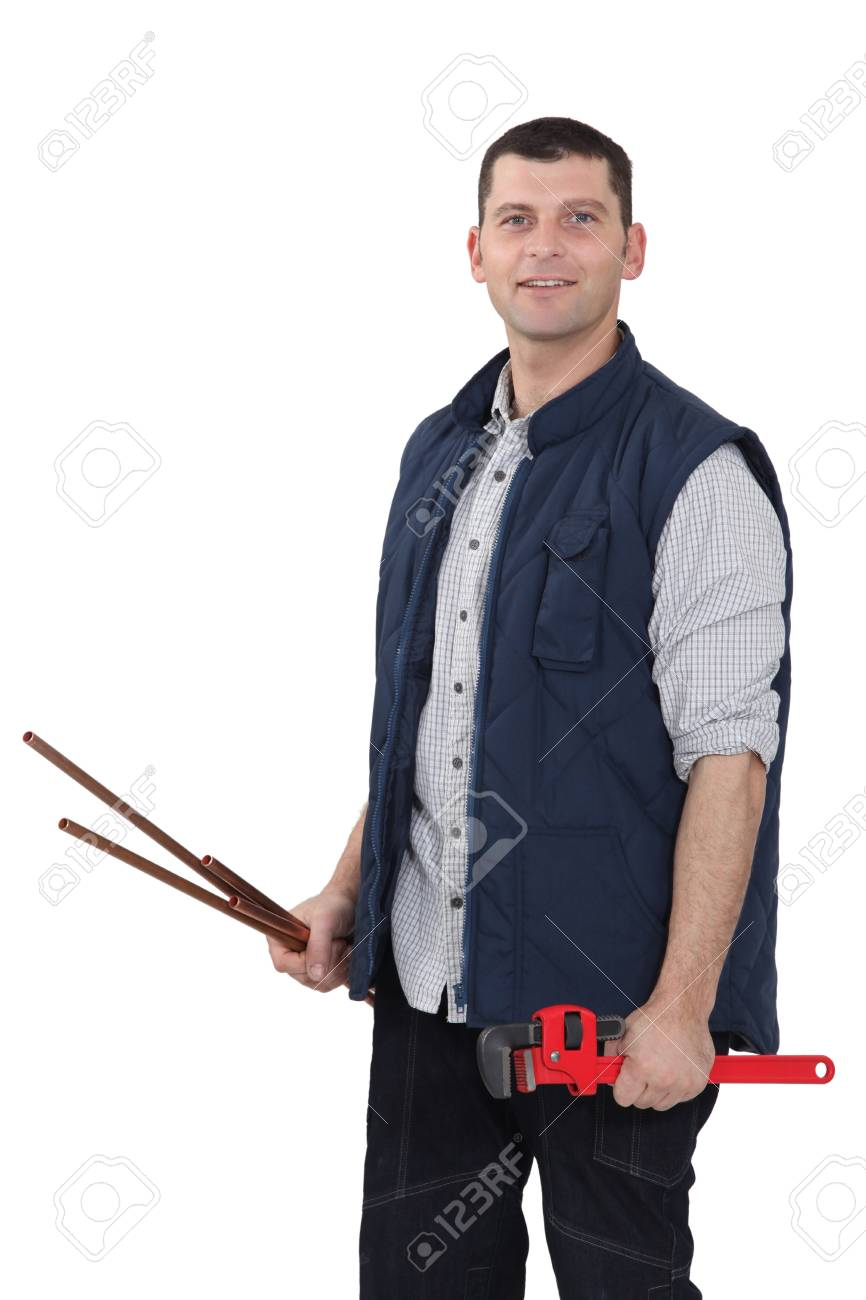Plumber holding wrench Stock Photo - 17219813