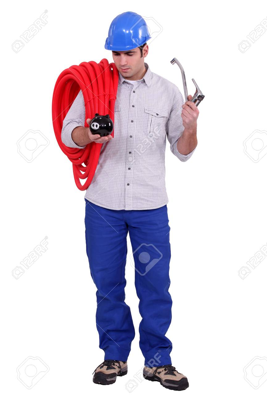 Plumber holding piggy-bank and tap Stock Photo - 17296830