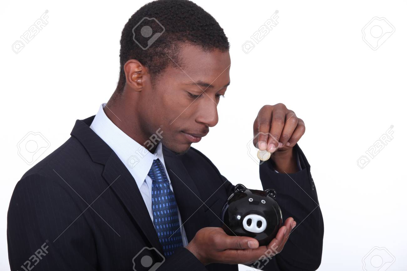 Man with pig-shaped piggy bank Stock Photo - 17386178