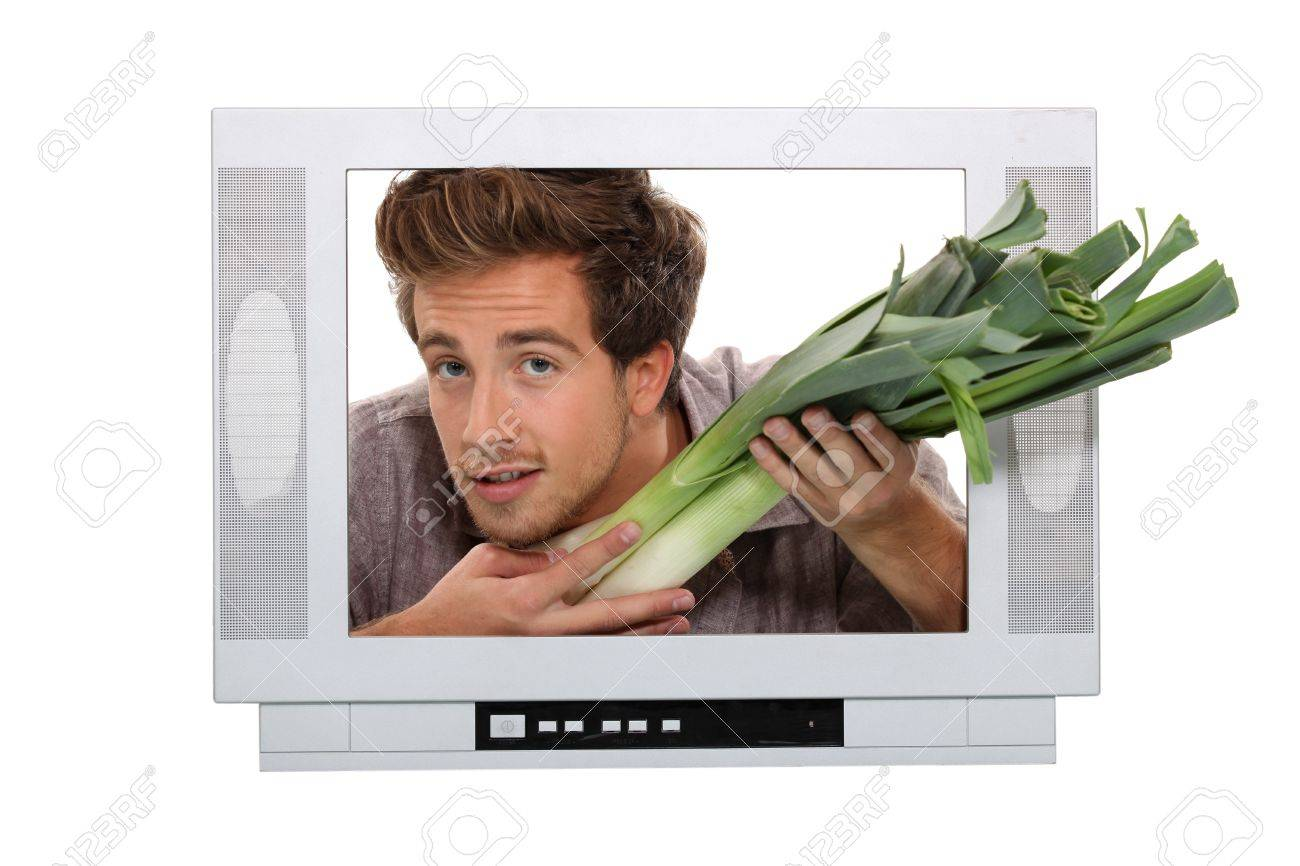 Man holding leek coming out of television Stock Photo - 17385221