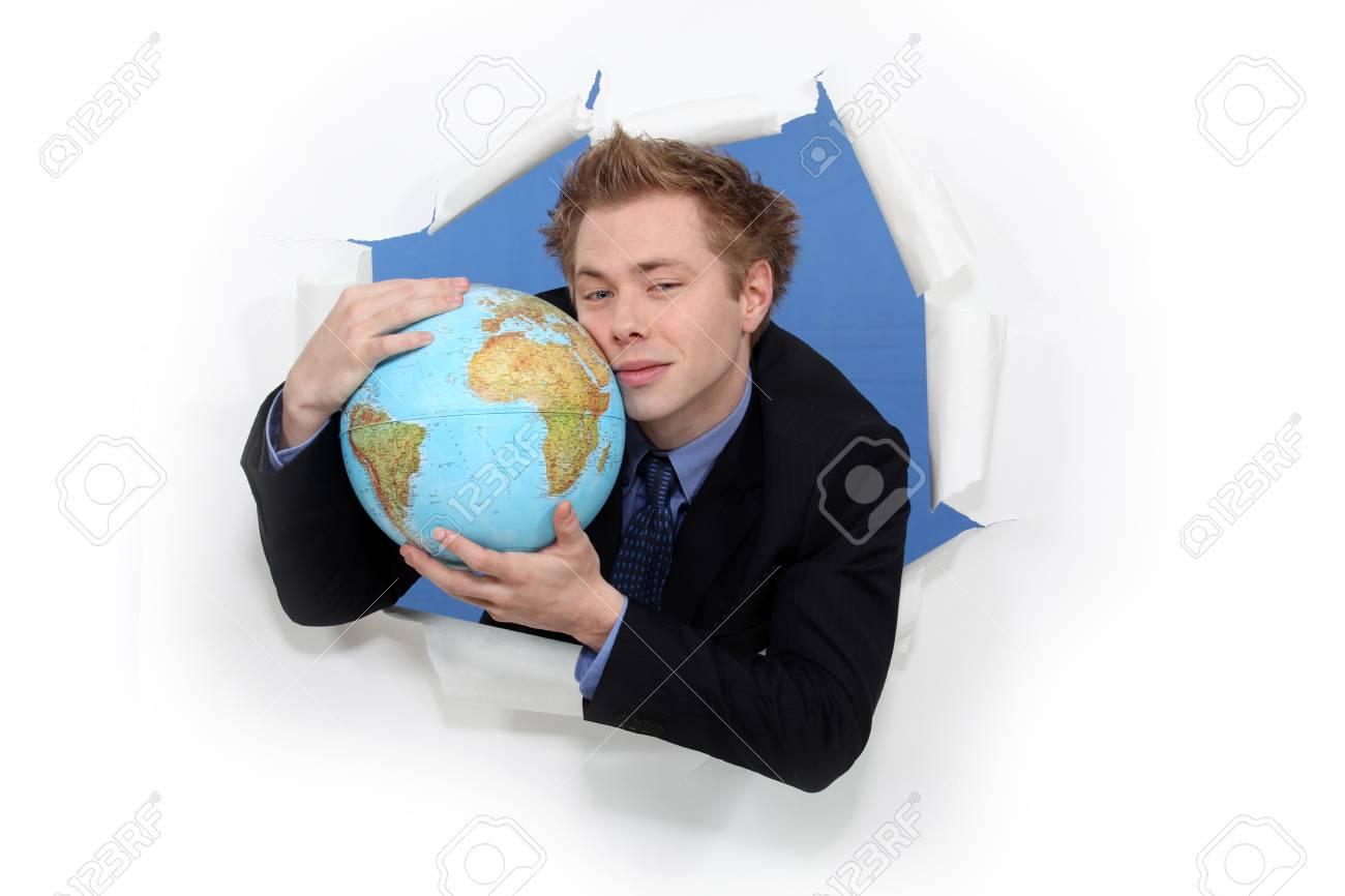Businessman hugging globe Stock Photo - 17577629