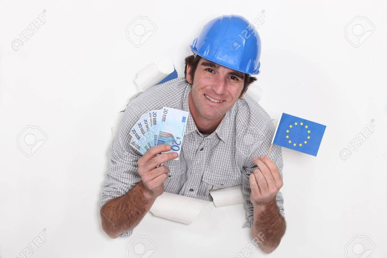 European builder with cash Stock Photo - 17584325