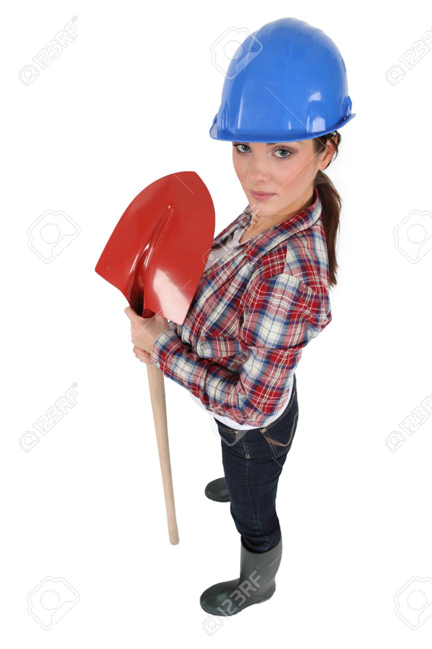 Female construction worker with a shovel Stock Photo - 17577555